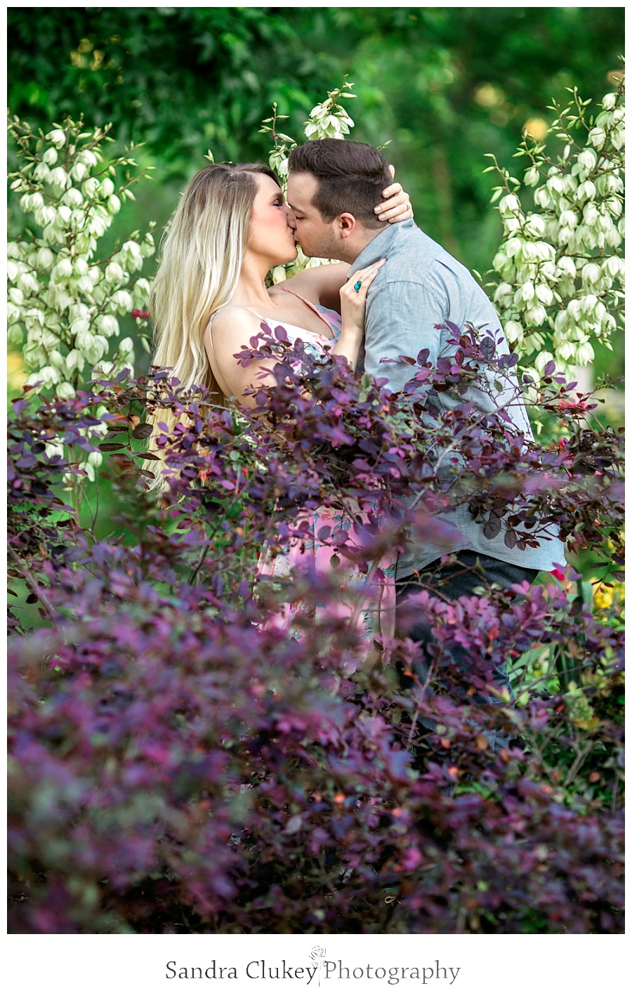 Passionate moment for couple in garden
