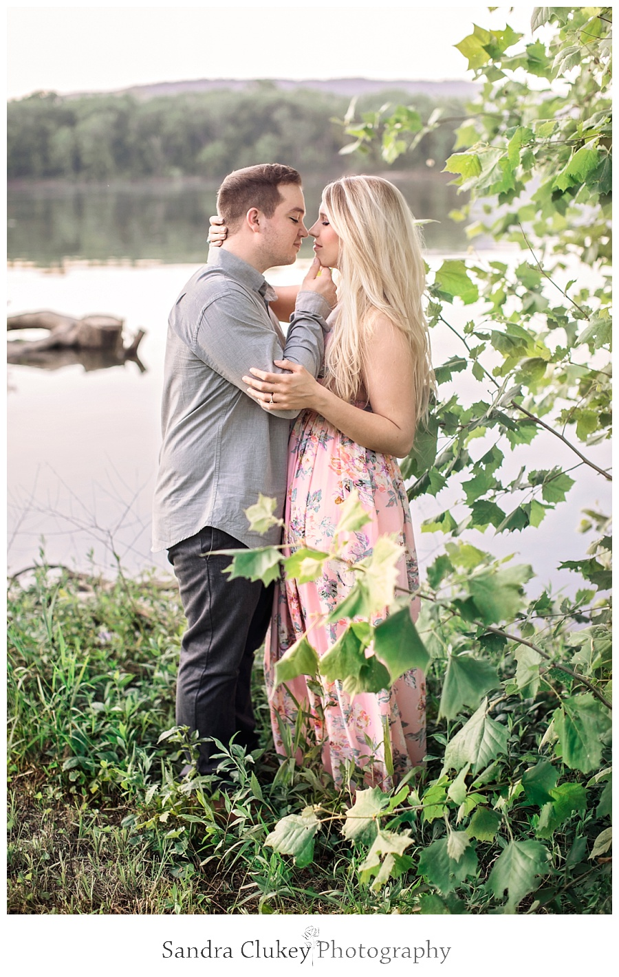 Tender moment for couple by river