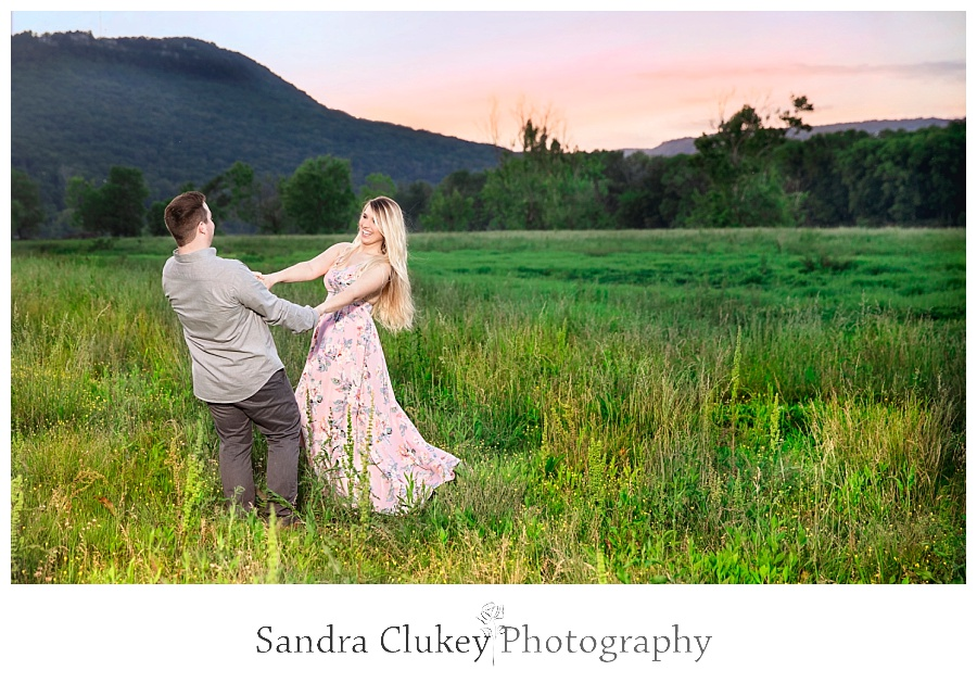 Engaged Couple dancing in sunset