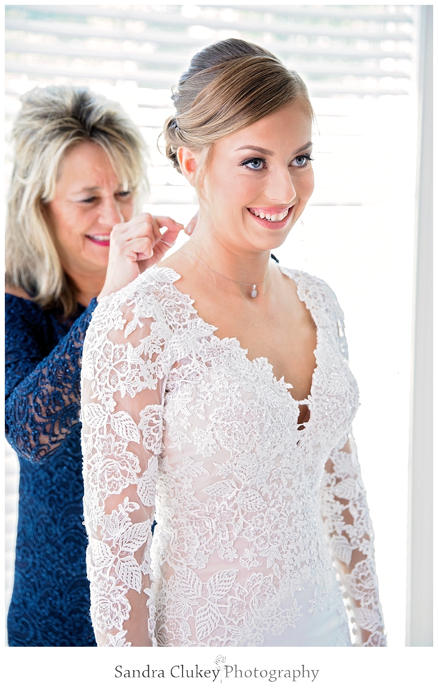 Mother of the bride helping bride get ready
