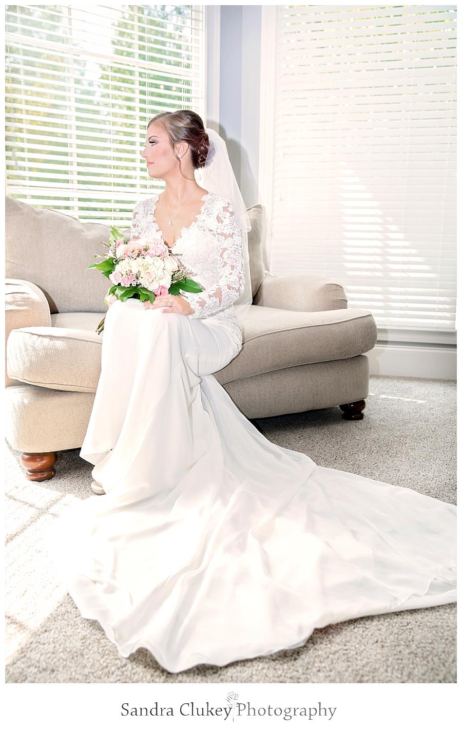 Exquisite bridal portrait of bride by window.