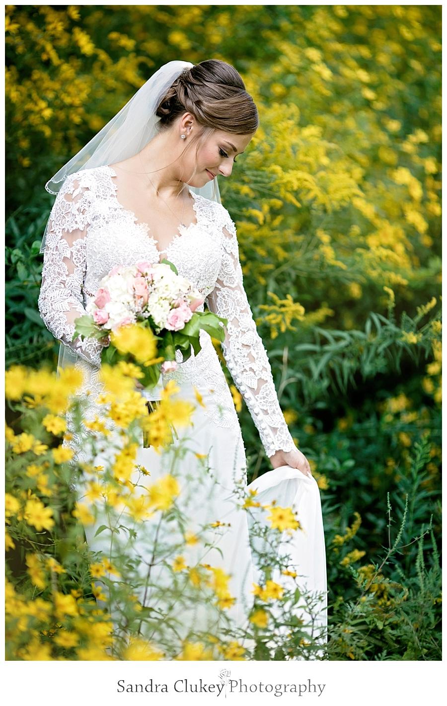Bride in flowers at Fletcher Park