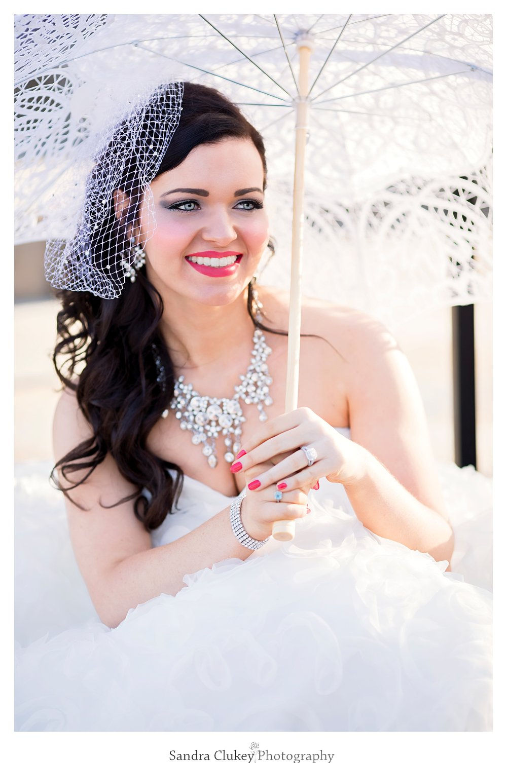 Lovely young bride with parasol at Lee University Chapel, Cleveland TN