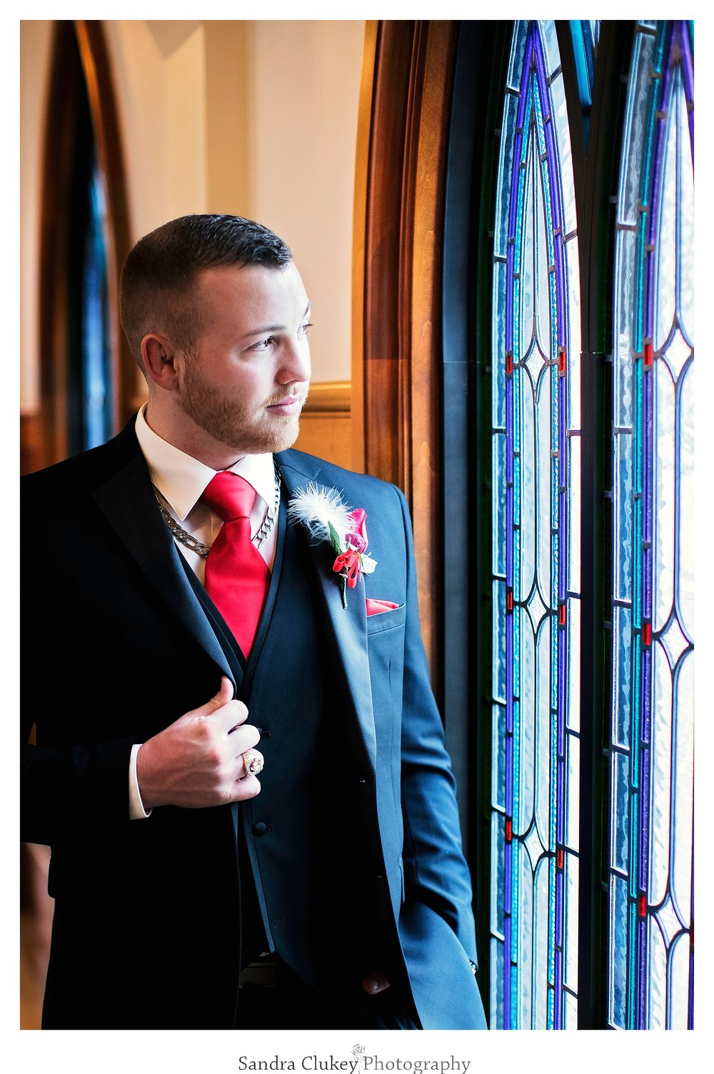Groom at Lee University Chapel's stained glass window's