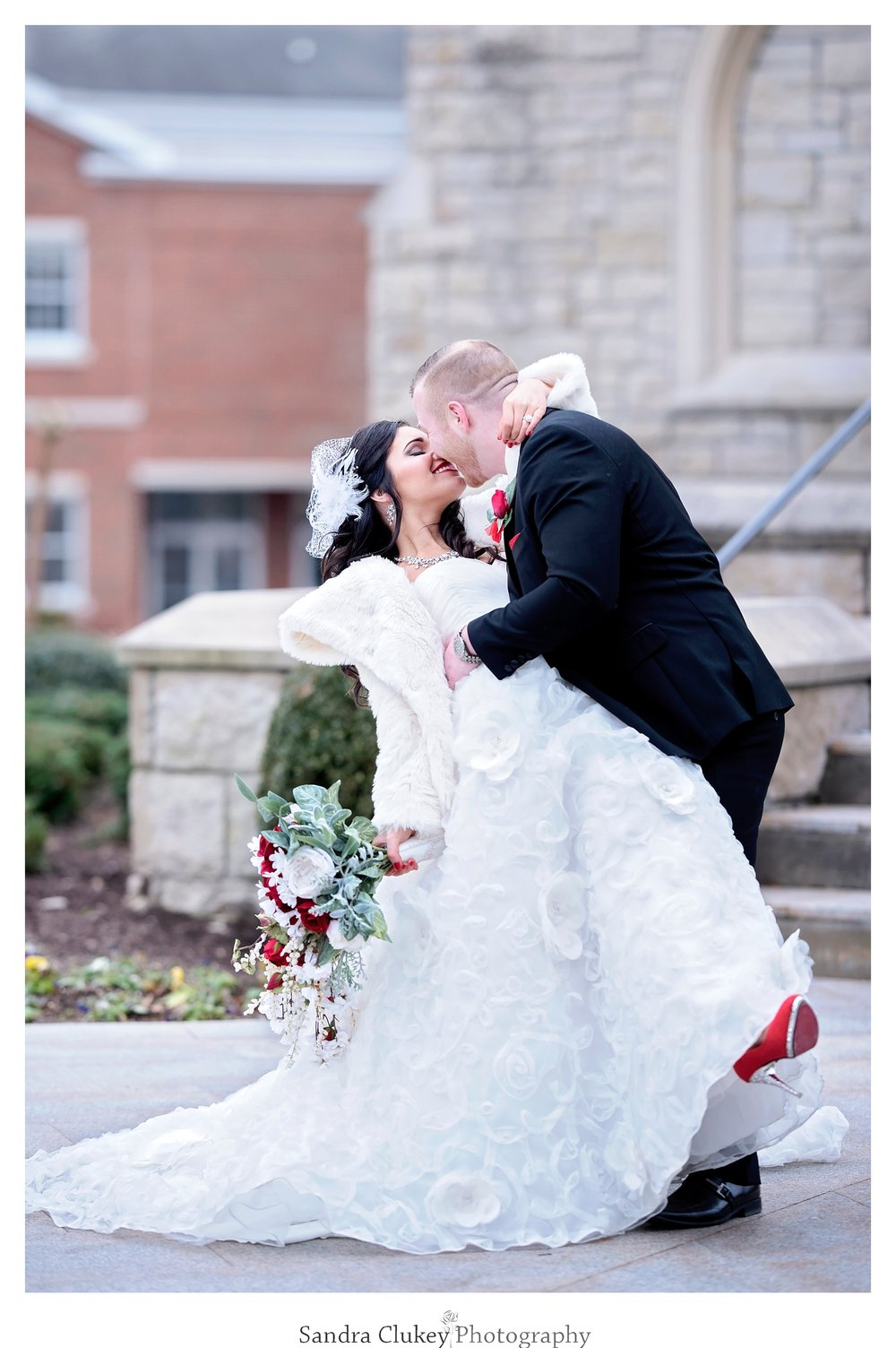 Groom and bride dip and kiss! Lee University Chapel, Cleveland TN