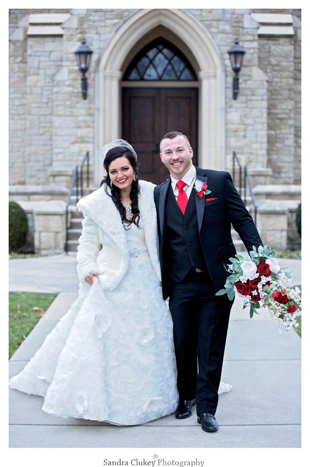 Lovely bride and groom on wedding day in front of  Lee University chapel, Cleveland TN.