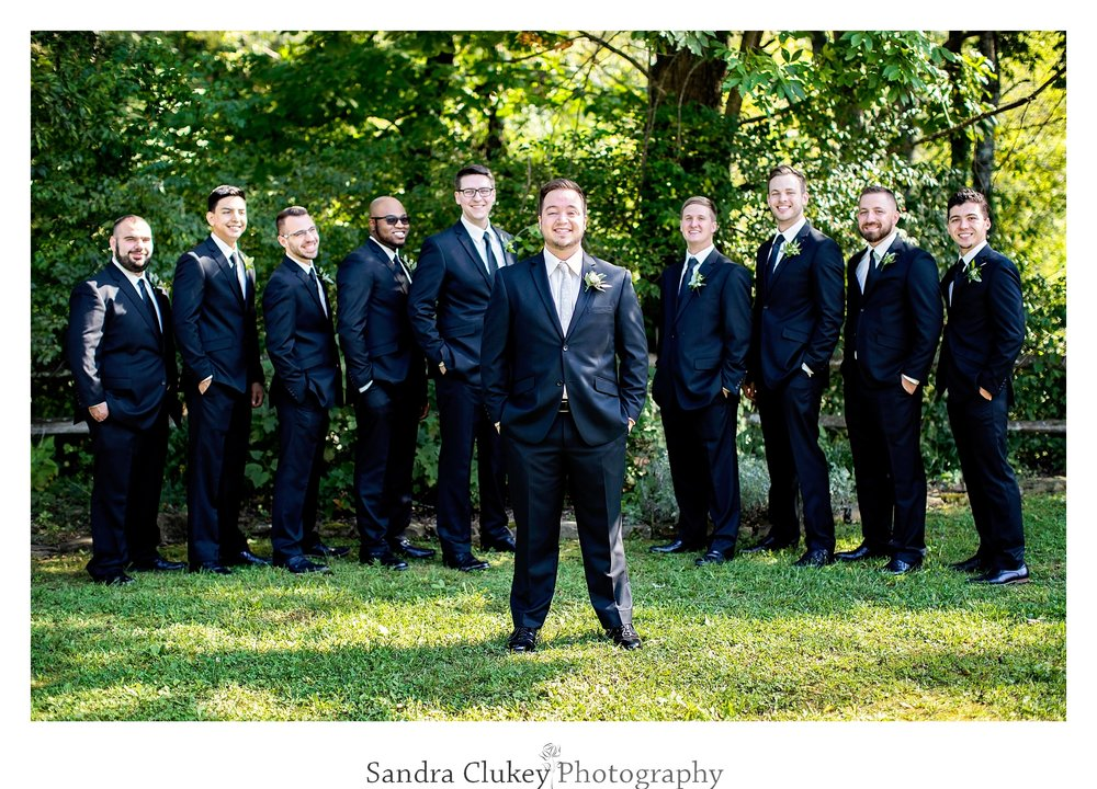 Happy groom stands out. Tennessee RiverPlace, Chattanooga TN