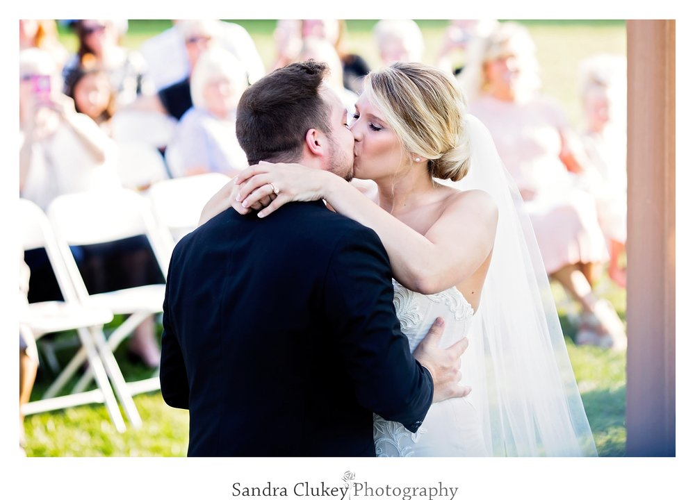 Sealed with a bride and groom kiss. Tennessee RiverPlace, Chattanooga TN