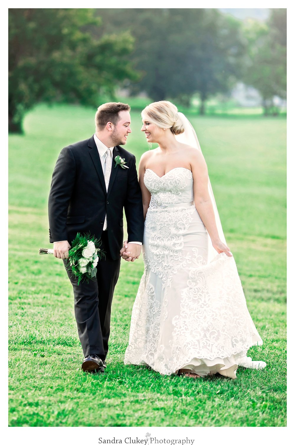 Bride and groom walk together at Tennessee RiverPlace, Chattanooga TN