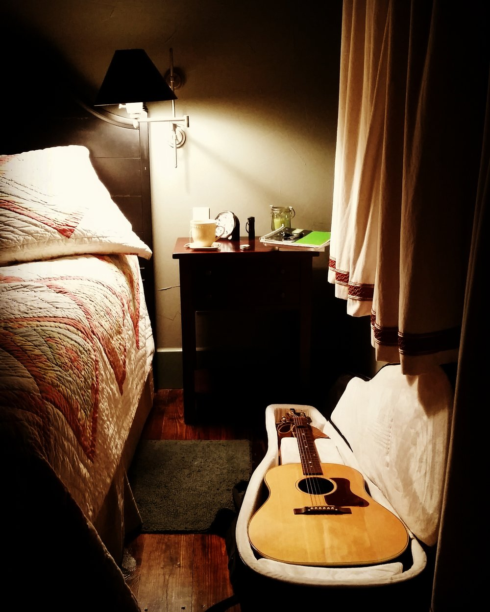 Happiness is... a quiet cabin, a bed with a quilt, and my guitar.