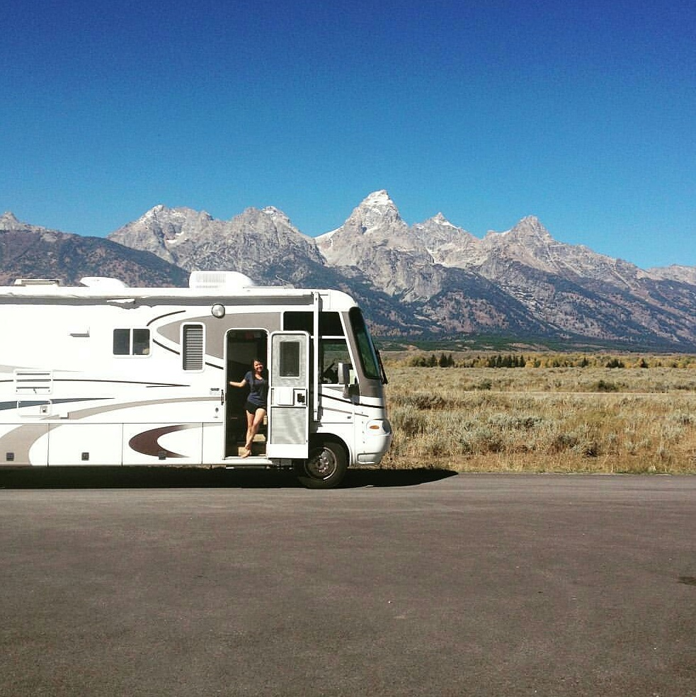 Our sweet RV home posing for a pic in front of the Grand Tetons.