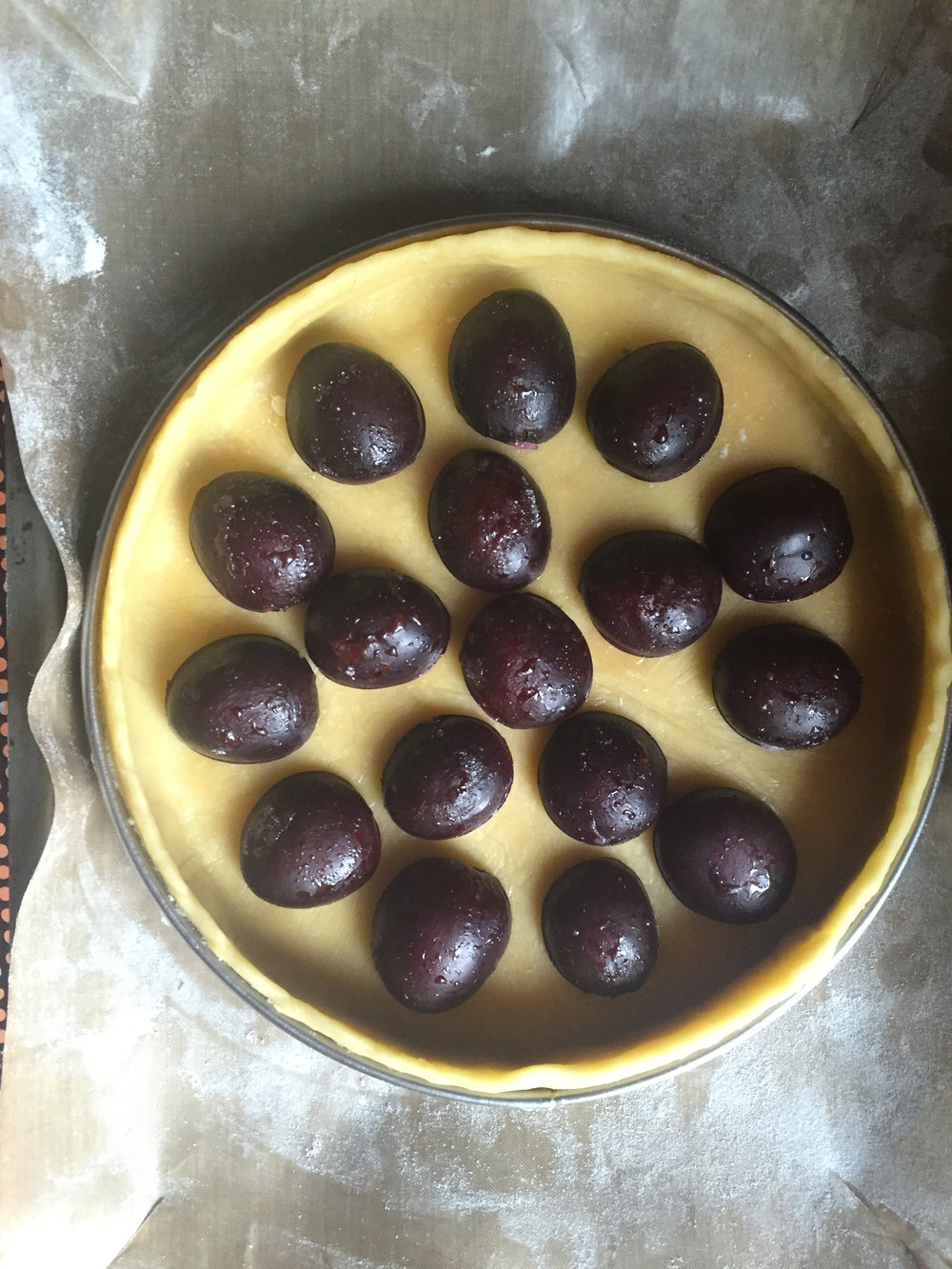 prepared plums in a prepared pastry