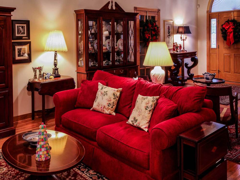 A living room with a red sofa.