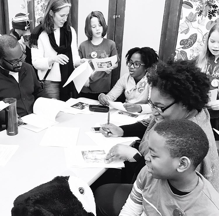 Students share their research papers in the Black Freedom Movement Study with a small group of peers and families.  Space is made for discussion after each share.