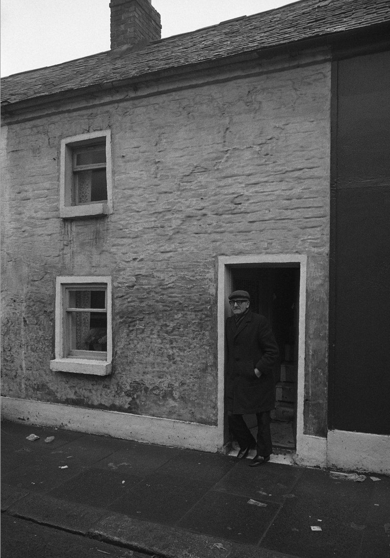 SR1974 - 9 Nipper Wilson at door, Rowland Way.jpg