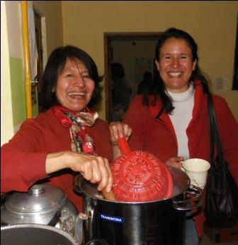 Volunteer, Maria eulogia, and her daughter Sofia making hot chocolate. Thanks for all the help.