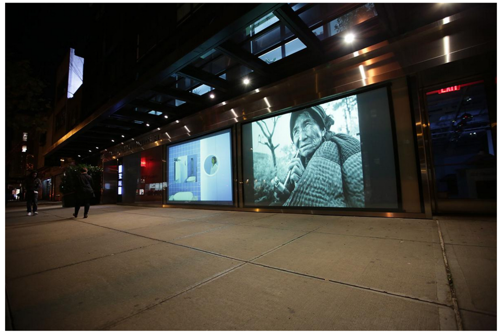 Images projected outside of the museum at night.