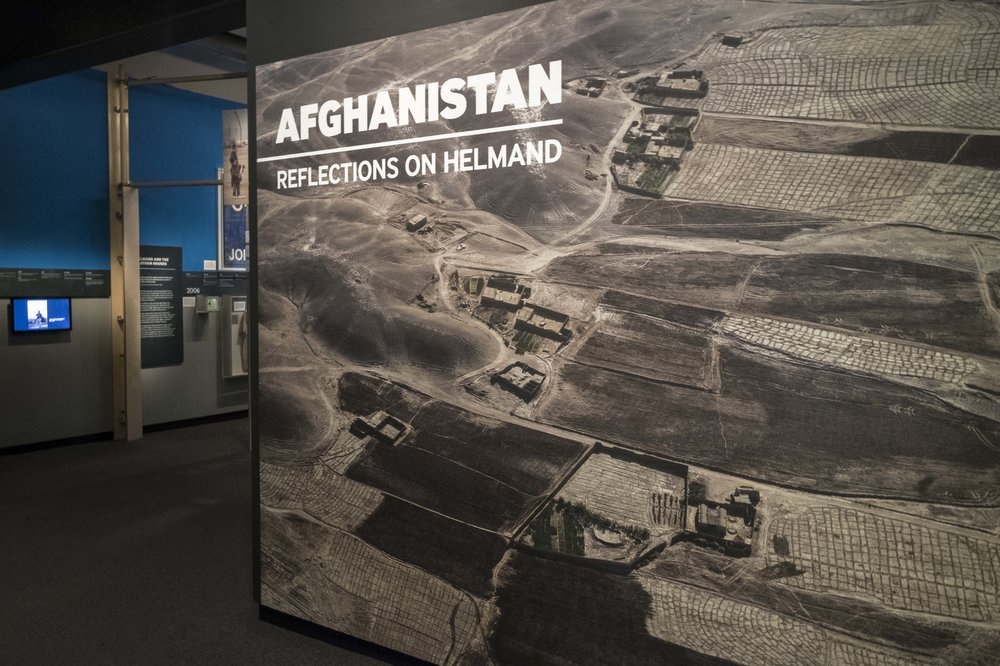 Afghanistan, Reflections on Helmand   Imperial War Museum, London, 2016   This exhibition examines the British arrival in Helmand province, Afghanistan, in 2006 and the decisions that shaped the way the conflict escalated, exploring the impact this period had on those who were there and the lessons learnt from this deployment.  The exhibition design is articulated around a timeline that helps the visitors to understand the relationship between the events that shaped the conflict. The graphics, printed on plywood, create a horizon line that echo the colours and the geometry of the Helmand province landscape.   Project completed with Plaid London
