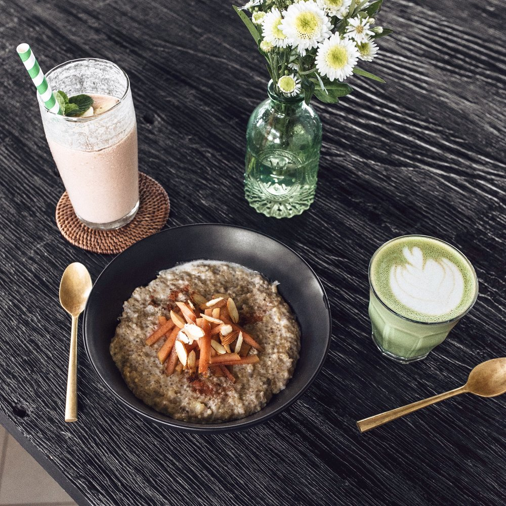 From left: chocolate smoothie, creamy quinoa porridge with cinnamon apples and almonds, and a chai matcha latte