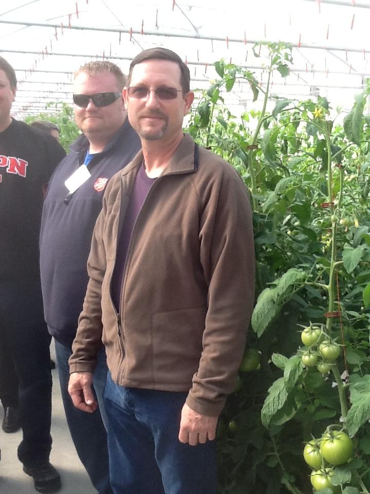 Cardinals Farms-Scott Garwood and tomatoes.JPG