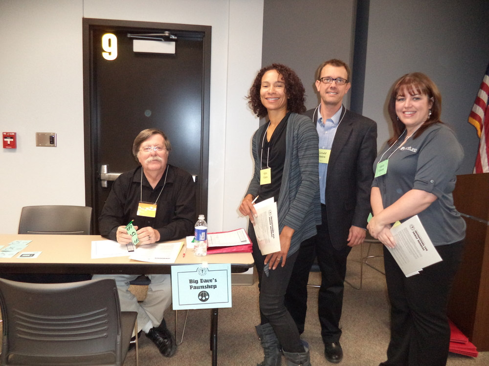 Poverty Simulation-Pawnshop-Dave Mixdorf, Denise, Ryan, Sara.JPG