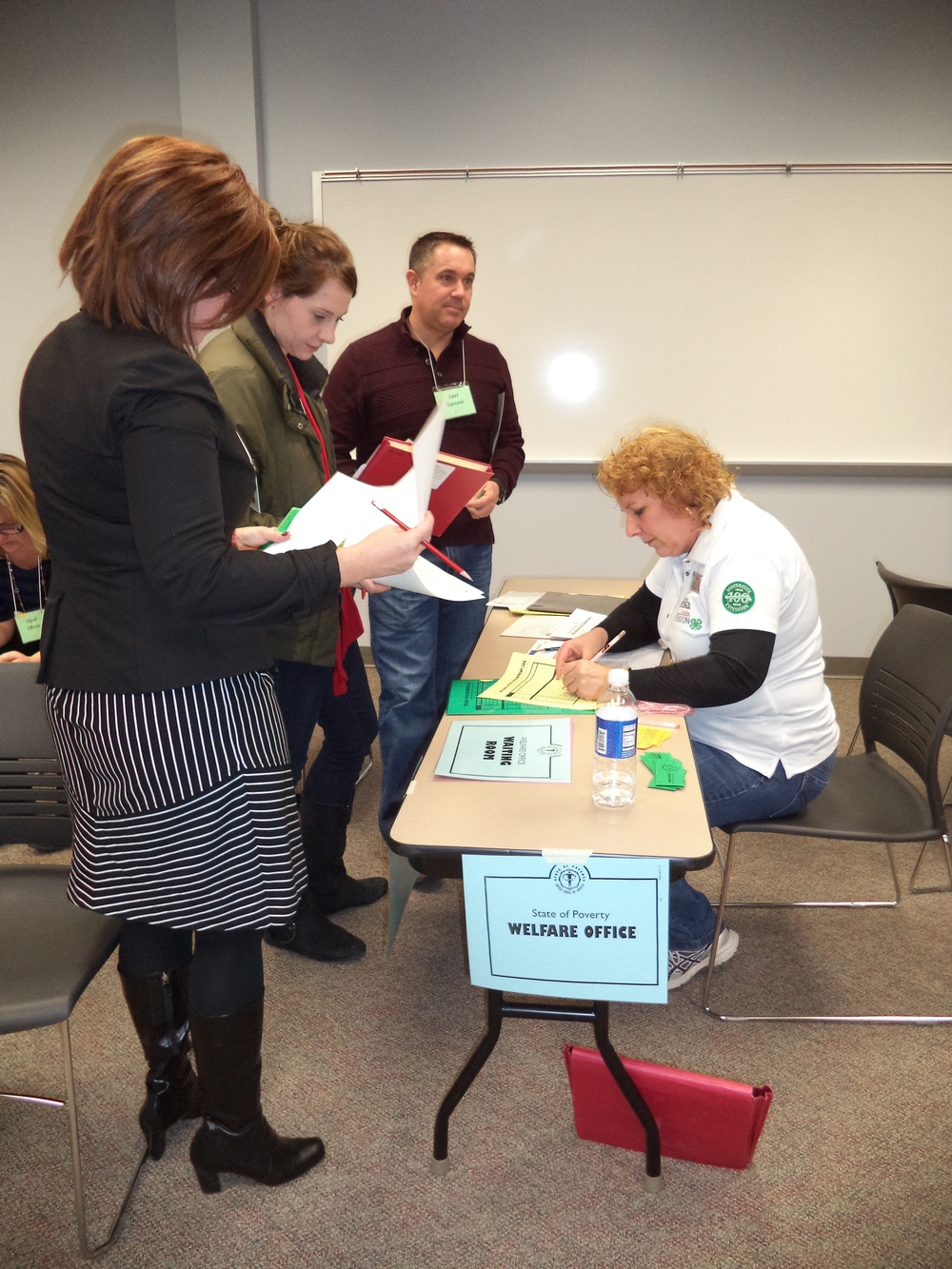 Poverty Simulation-Welfare Office-Tammy Peterson, Alex, Eric, Heidi.JPG
