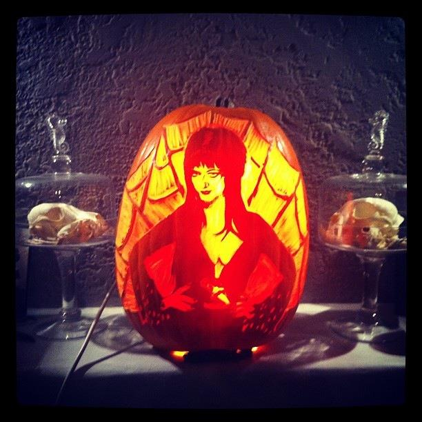 Melissa as Elvira on a pumpkin.  Carved by the talented and doting Tim Lagasse on their anniversary.