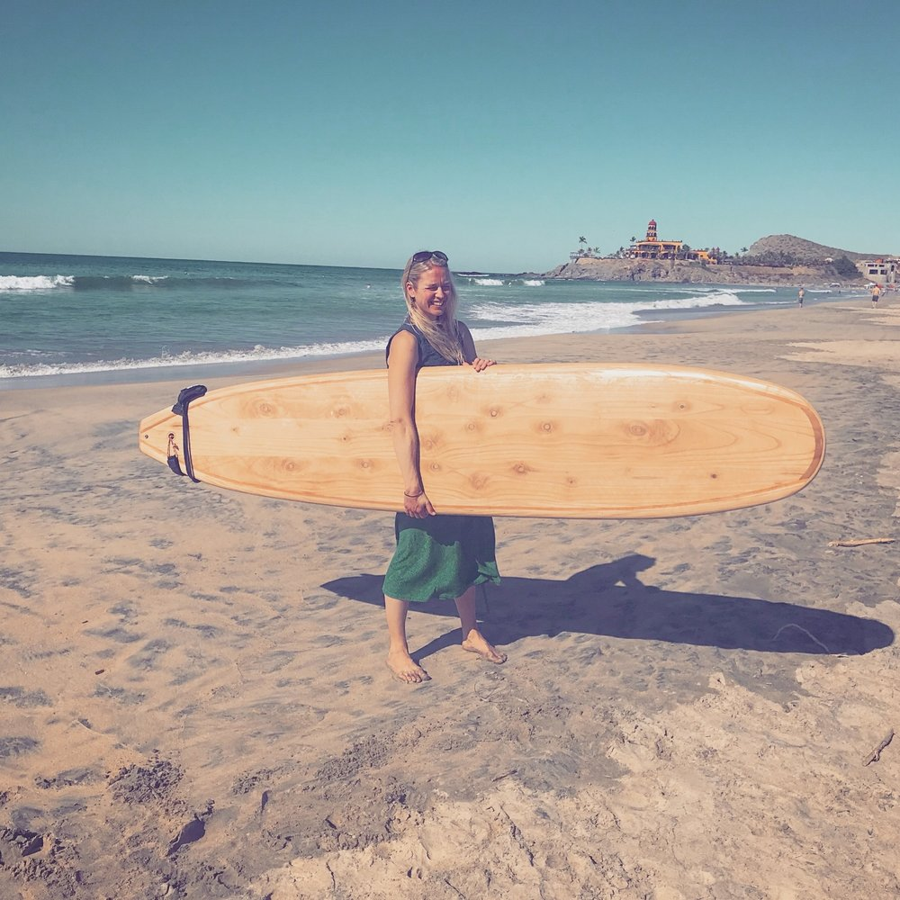 "Elie with an 8'6"" longboard at Cerritos Beach, near Pescadero, Baja Sur, Mexico."