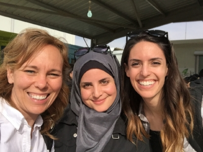 Kelli, Nadin and Carly (team member) squint in the sun for a picture.