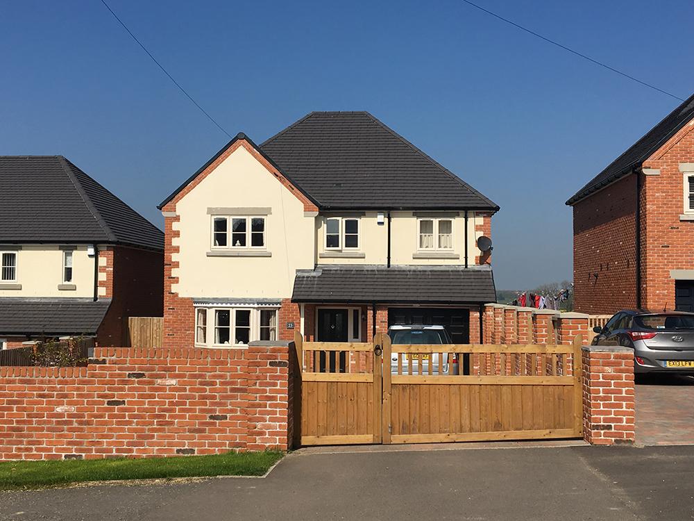 render and red brick housing development