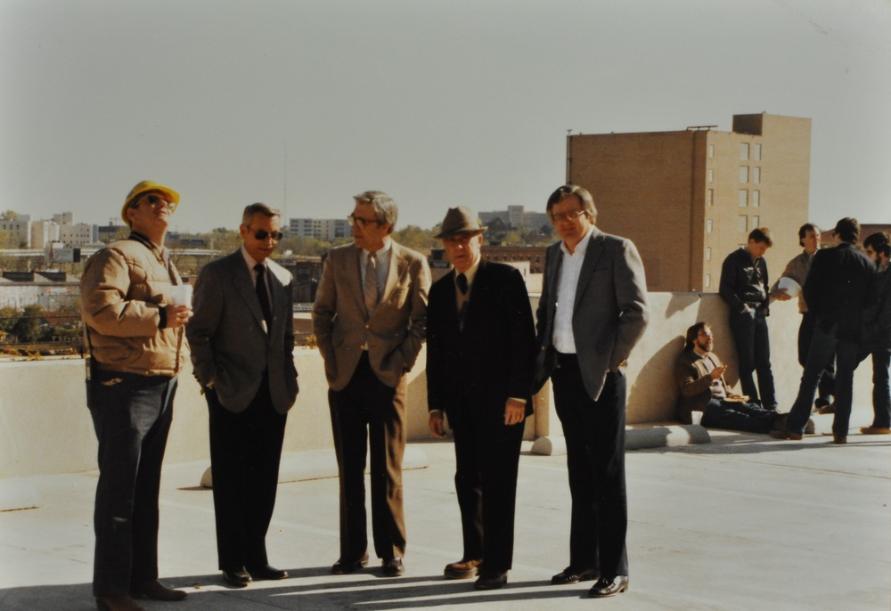 H.W.G. Golden, Grady and Bill Golden, J.W. Herring and a bank office are shown in this picture from 1988 atop the Commercial National Bank parking garage.