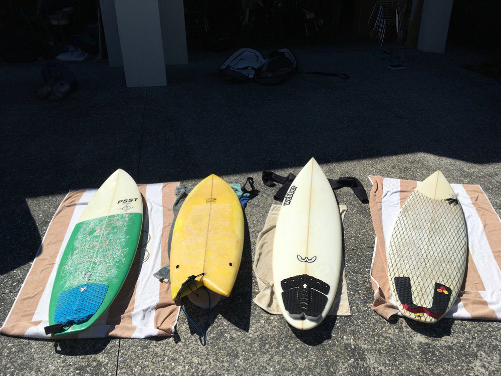 The Indo quiver.  From left to right:   [The all arounder/pointbreak machine.  The fish.  The step-up/gun.  The go-to shortboard.]