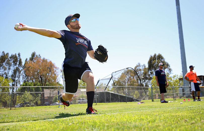 Sonoma Stompers pitcher Sean Conroy, left, warms up during practice at Arnold Field, in Sonoma, Calif. on Tuesday, June 23, 2015. Conroy, 23, of Clifton Park, N.Y., is the first openly gay player to enter the professional baseball ranks, according to the Stompers.   Christopher Chung/The Press Democrat via AP