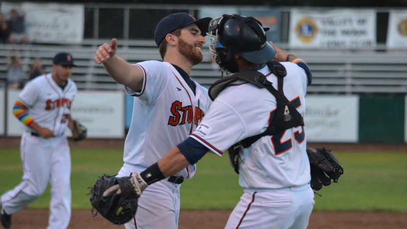 Sean Conroy gets a congratulatory hug from Isaac Wenrich after throwing a 3-hit shutout on Pride Night as the first openly gay active player in professional baseball.   James Toy III/Sonoma Stompers