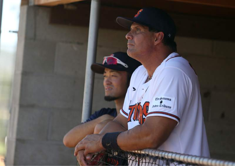 Jose Canseco hangs in the dugout with Sonoma Stompers infielder Yuki Yasuda prior to the game against the San Rafael Pacfics at Arnold Field in Sonoma on June 12, 2015.   Crista Jeremiason/The Press Democrat