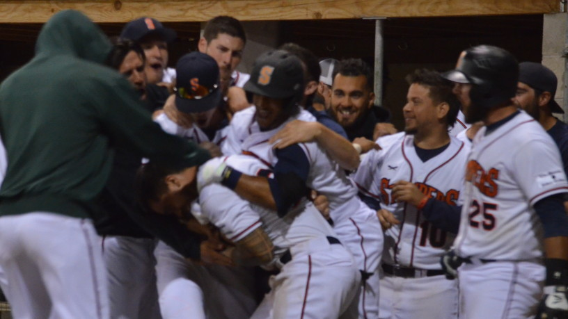 Mark Hurley is mobbed by his teammates after he scored the winning run on a wild pitch in Sonoma's come-from-behind victory on Wednesday night. Hurley scored twice on wild pitches in the game.   James Toy III/Sonoma Stompers