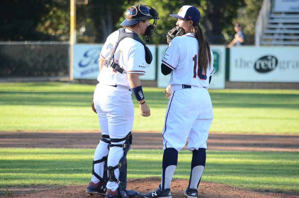 Anna Kimbrell, left, and Kelsie Whitmore, right, talk over strategy during Friday's game at People's Home Equity Ballpark in Sonoma, the first all-female battery in the history of men's professional baseball.   James Toy III/Sonoma Stompers