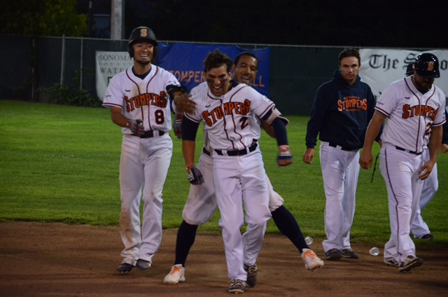 Third baseman Eddie Mora-Loera and center fielder Matt Hibbert celebrated a walk-off win Sunday in a 5-4 win over the Diamonds.    James Toy III/Sonoma Stompers