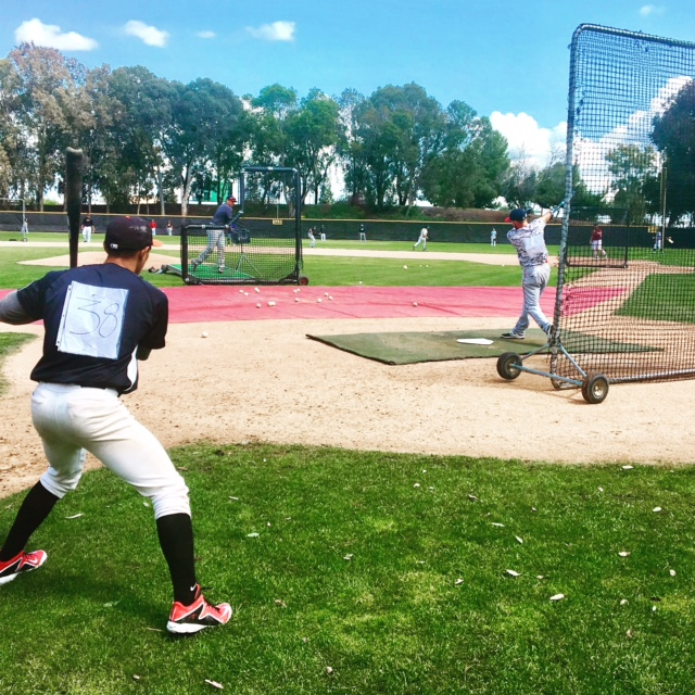 Infielder Ryan Wheat (right) taking batting practice at the Pacific Association Tryout at Los Medanos College in Pittsburg, California.
