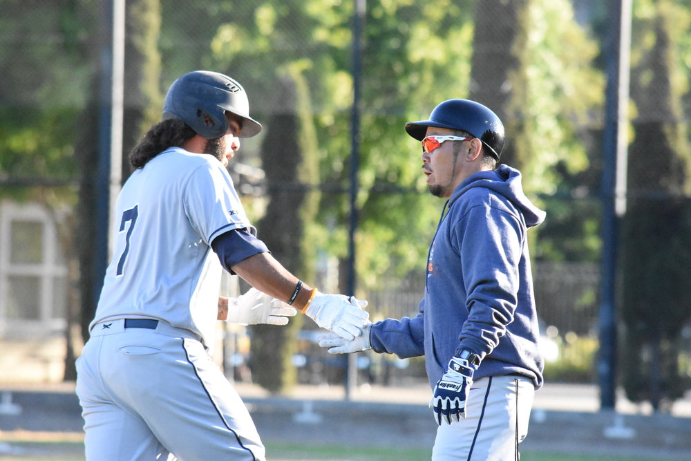 Stompers manager Takashi Miyoshi congratulates Joel Carranza as he rounds third after his first home run of the season. Carranza is now one shy of the all-time Pacific Association record for home runs in a career. (James W. Toy III / Sonoma Stompers)