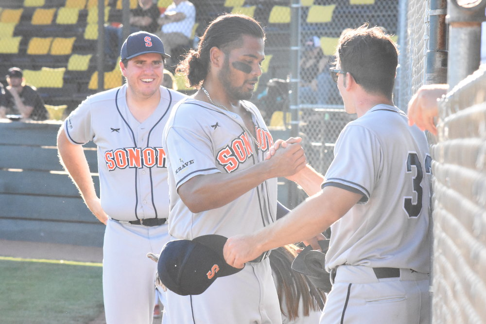 Daniel Baptista (center) went 4 for 6 in his 2017 debut in the Sonoma Stompers' 17-14 victory over the Pittsburg Diamonds on Thursday at Winter Chevrolet Stadium. (James W. Toy III / Sonoma Stompers)