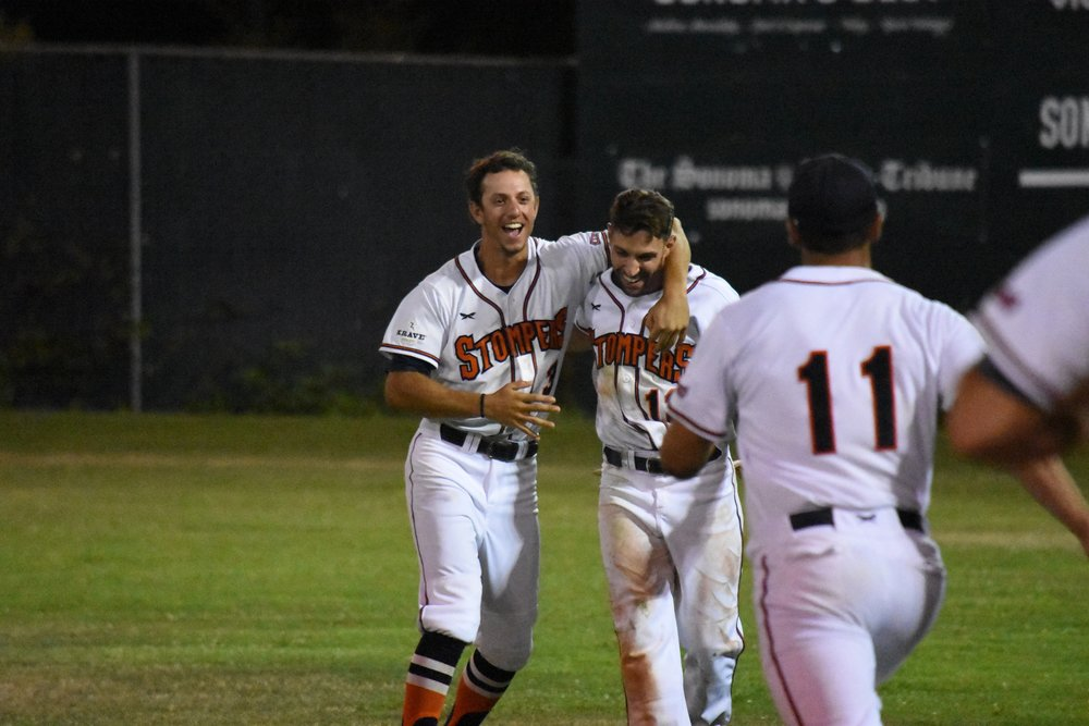 Matt LoCoco (left) and Brennan Metzger (right) celebrate after Metzger hit a game-winning single to defeat the Pittsburg Diamonds 6-5 at Peoples Home Equity Ballpark on Saturday. (James W. Toy III / Sonoma Stompers)