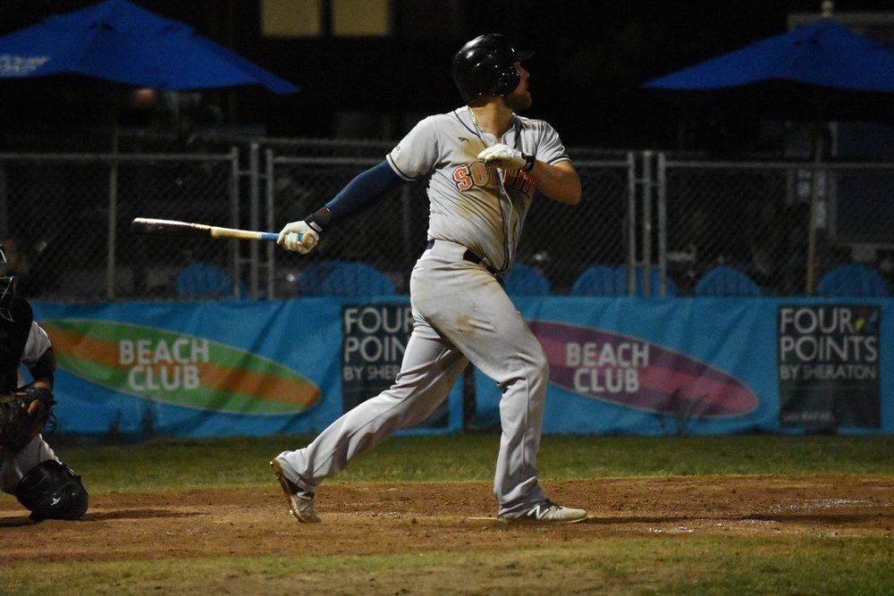 Scott David hits an RBI single to give the Sonoma Stompers a three-run lead against the San Rafael Pacifics in the tenth inning on Thursday at Albert Park. (James W. Toy III / Sonoma Stompers)