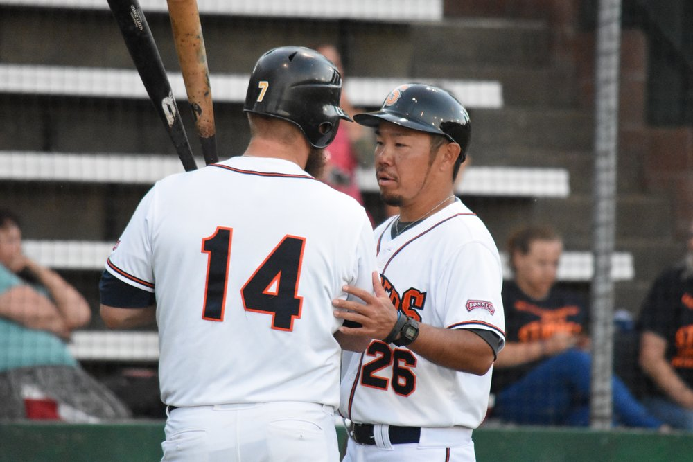 Manager Takashi Miyoshi speaks with infielder Scott David during a 2017 home game at Peoples Home Equity Ballpark at Arnold Field. (James W. Toy III / Sonoma Stompers)