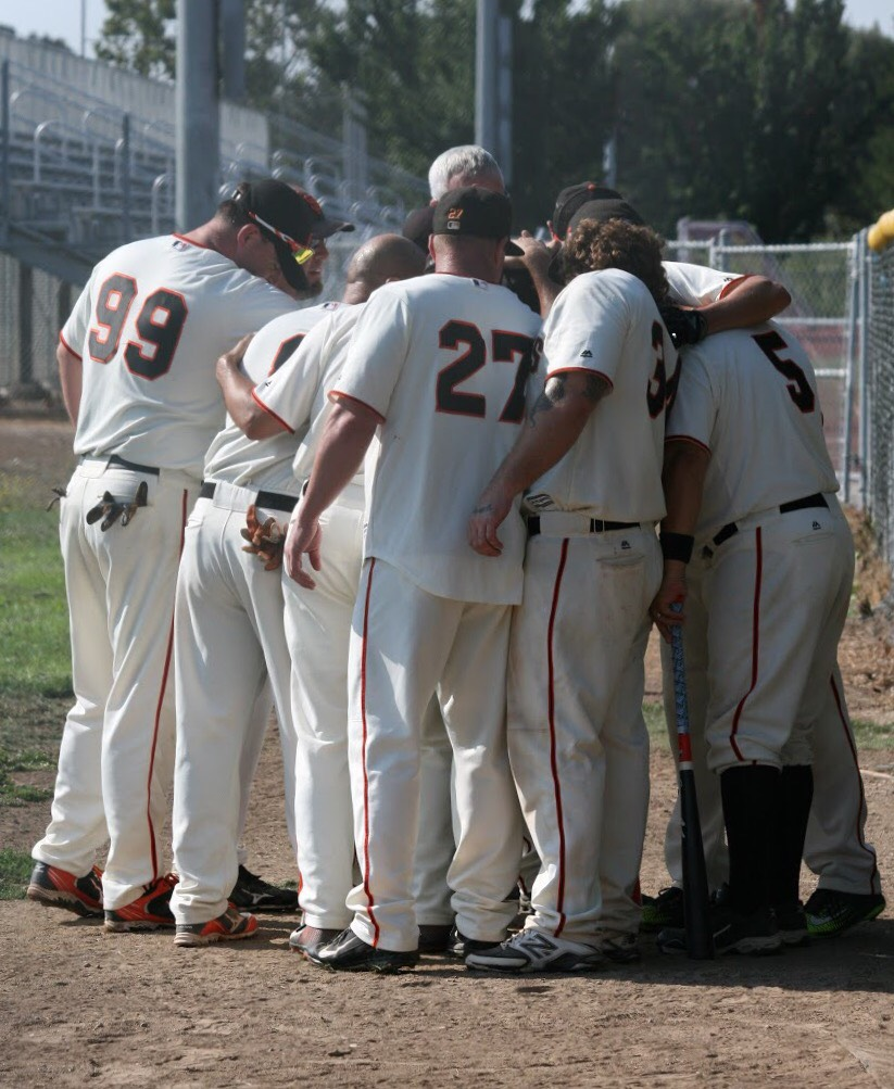 Thornhill and his Rebl Baseball League teammates embrace during his first game back from surgery. (Photo courtesy of Casey Thornhill)