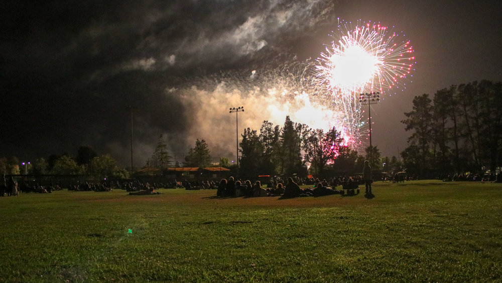 Fans enjoy the world-famous Sonoma fireworks from the field at Palooza Park at Arnold Field on July 4th, 2018. (Nicholas Badders / Sonoma Stompers)