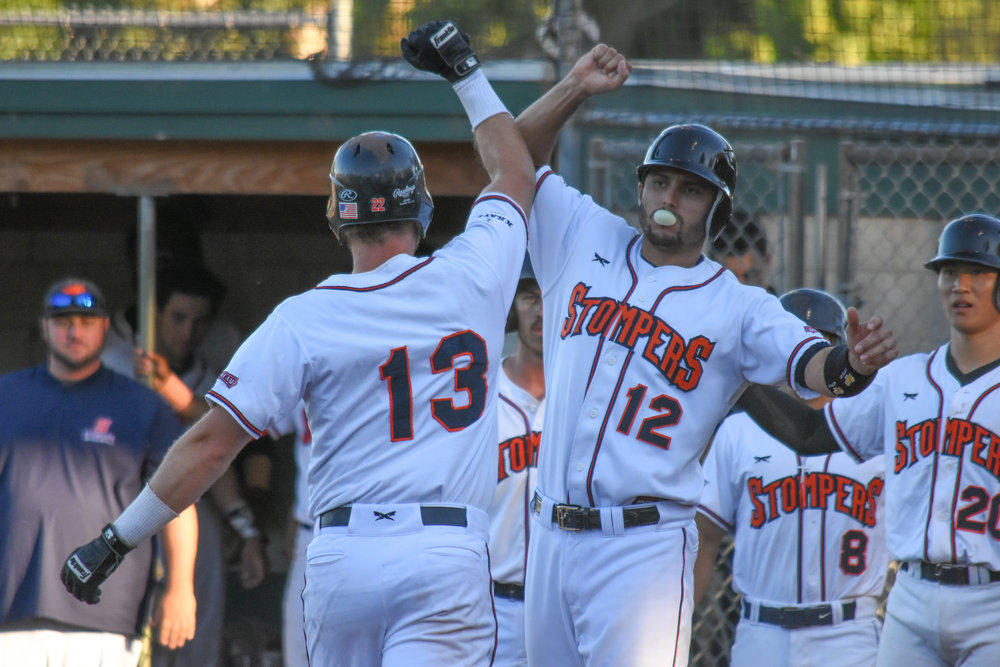 Kevin Farley (13) celebrates with Kenny Meimerstorf (12) after hitting his third home run of the season, a three-run home run in the fourth inning in the Sonoma Stompers game against the Vallejo Admirals, Tuesday, July 17, 2018. (James W. Toy III / Sonoma Stompers)