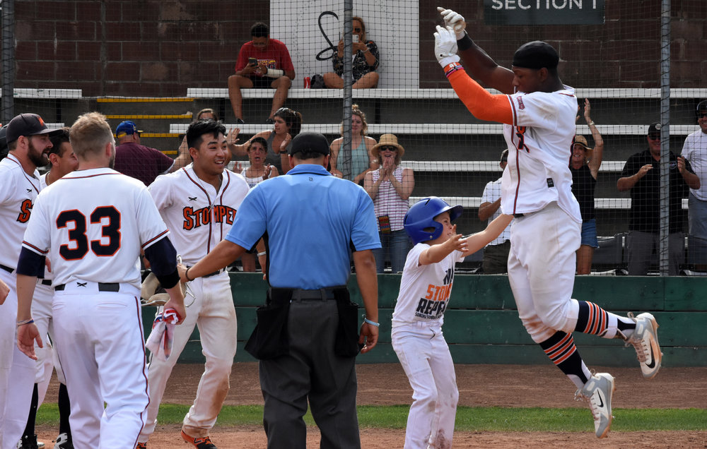 Miles William (18) celebrates his walk-off home run in the Sonoma Stompers game against the Pittsburg Diamonds, July 29, 2018 in Sonoma, Calif. (James W. Toy III / Sonoma Stompers)