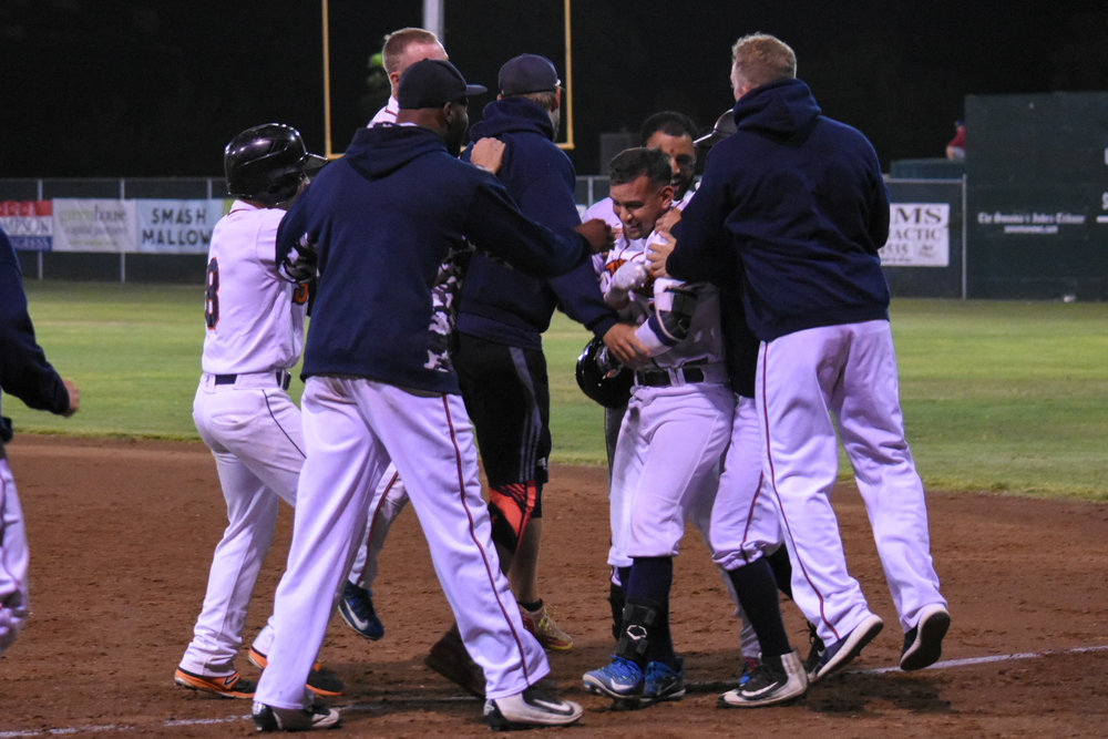 Eddie Mora-Loera celebrates with his teammates after the Sonoma Stompers' walk-off win in their game against the San Rafael Pacifics, July 31, 2018 in Sonoma, Calif. (James W. Toy III / Sonoma Stompers)