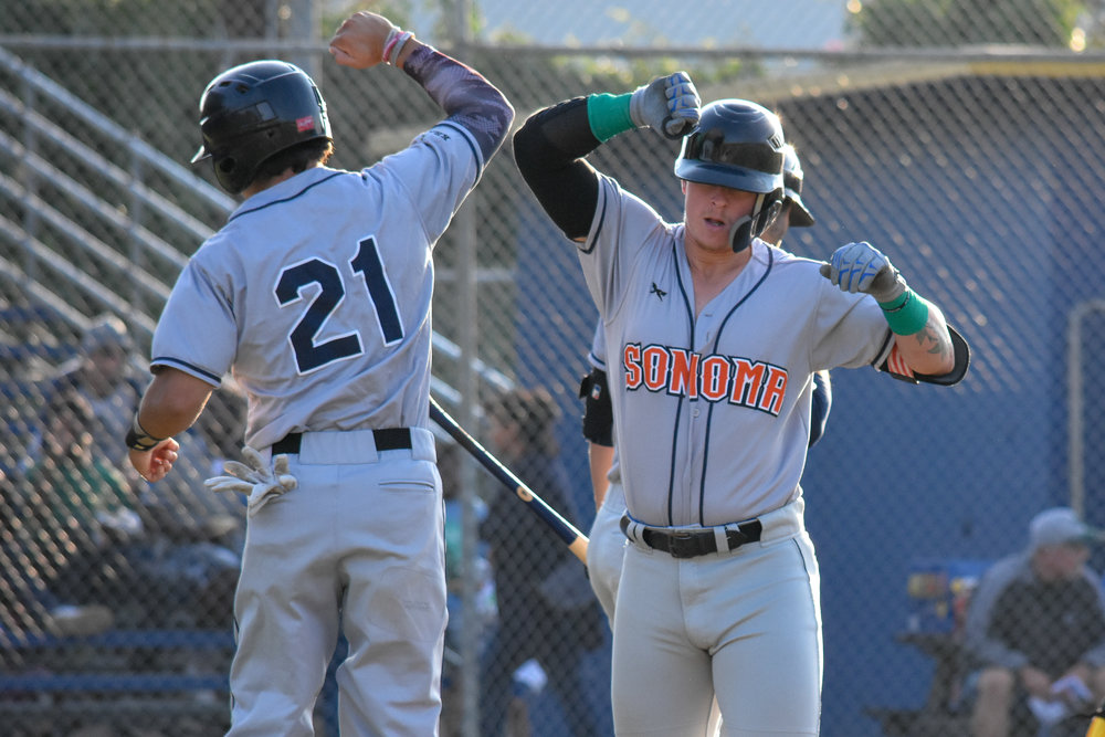 Kam Stewart celebrates with Rob DeAngelis (21) after hitting his 10th home run of the season, a two-run shot in the first inning of the Sonoma Stompers game against the Vallejo Admirals, August 15, 2018 in Vallejo, Calif.(James W. Toy III / Sonoma Stompers)
